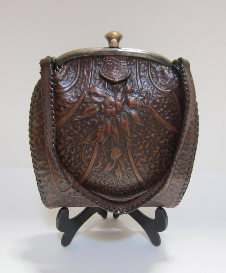 Art Nouveau leather arts and crafts purse by Jemco. $135.00, via Etsy.