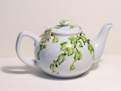 Fabulous hand painted white ceramic tea pot painted with decorative  green ivy makes for a special gift to any tea lover. This is a unique  one of a kind painted by hand by Laurie Rohner. Large enough to fill up  the two painted mugs or 4-6 tea cups. Excellent condition.  A simple design of ivy falling down the sides decorates this teapot.   Painted with Ceramic Specialty Paints. These paints are baked on and are dish washer safe as per manufacturer but I advise you to hand wash.   Cream and…