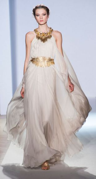 If you wanted to go for some serious head turns, this dress would be it! I love this look for your Isles of Greece themed Wedding. It is just so perfect and chic!