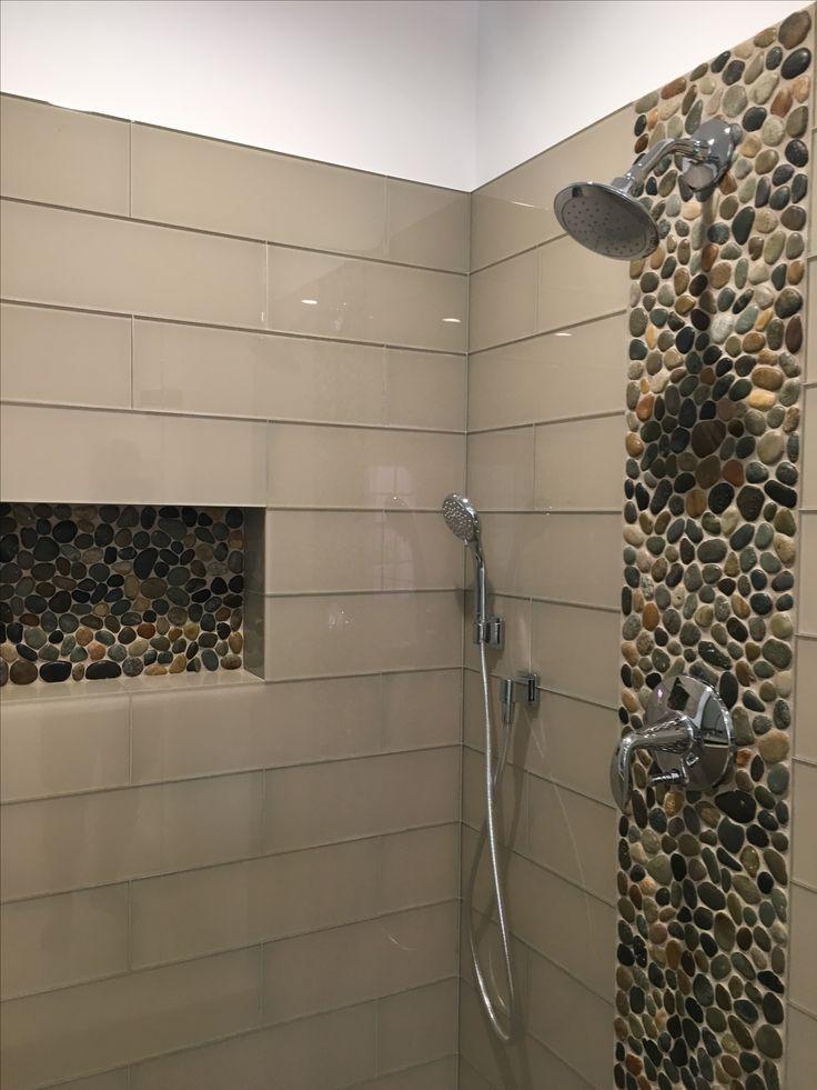 Stunning accent strip and niche using Glazed Bali Ocean Pebble Tile. https://www.pebbletileshop.com/products/Glazed-Bali-Ocean-Pebble-Tile.html#.V9xHv_krKUk