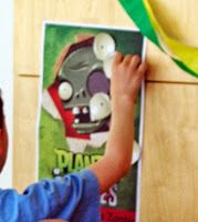Plants vs Zombies Birthday Party--pin the eye on the zombie game