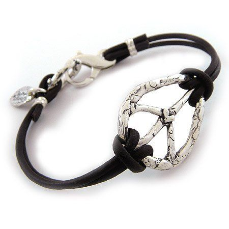 """Island Cowgirl Live in Peace Bracelet - Sterling Silver Plate and Leather Island Cowgirl. $67.99. Plated in sterling silver, with 5x the amount of normal plating to prevent wear and provide a higher quality standard. Durable, knotted chocolate-brown leather cording. Made in the USA. Sterling silver plated 1-3/8"""" elongated peace sign emblazoned with a heart. Measures 7-1/4"""" with a double-plated sterling silver lobster-claw clasp"""