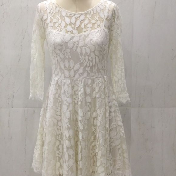 NWT Free People dress with delicate details sz 6 Gorgeous new with tag off-white dress with delicate lace details, a-line skirt and gorgeous 3/4 sleeves. Size 6 is equivalent to a Size M, very confortable has a fine cotton lining. Retails for $128 + tax and shipping! Free People Dresses