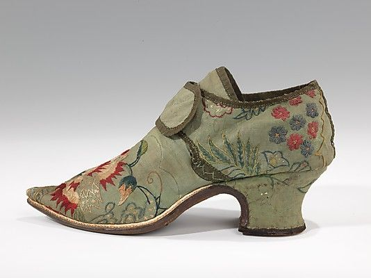 This is a very pretty shoe with lovely flower embroidery! (Shoe, 1720-1749, British, silk? This shoe in the classic shape of the period is a representative example of early 18th century domestic needlework in a popular Indian-inspired floral design. In some areas the embroidery has worn away, showing how the design was first drawn on the fabric in pencil. (c) The Metropolitan Museum of Art)