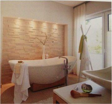 natursteinwand hinter badewanne