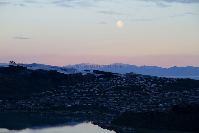 Snowy morning moon over the South Island of New Zealand and Titahi Bay, Porirua, Wellington | © Elyse Childs Photography