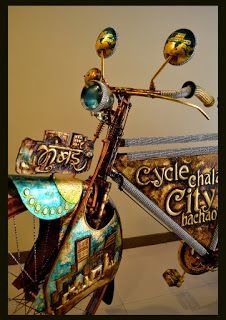 "Gold leaf, Hand painted, Metal embossed, ""Mumbai cycle"". Art installation by Indian artist Rajesh Nakar from JUST MADE FOR DESIGN"