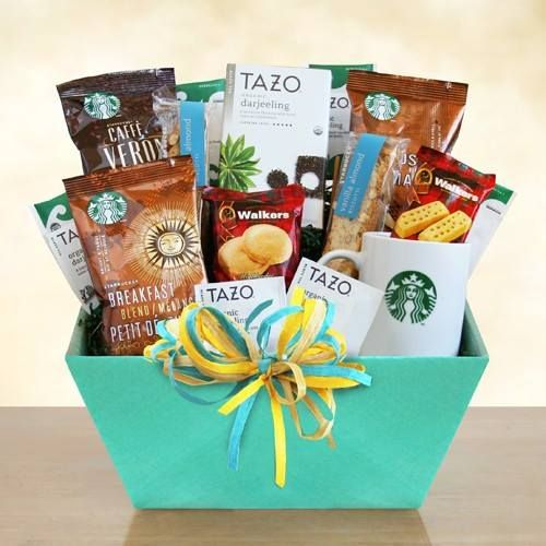 Starbucks Surprises - Gift Basket - This classic Starbucks gift of coffee and tea will be a huge hit. A verdant green box holds a ceramic Starbucks logo mug and everything needed to fill it. They will get three varieties of Starbucks coffee, including Breakfast Blend, Caffe Verona and House Blend. A box of Tazo organic Darjeeling tea is ready to be enjoyed along with sweet vanilla almond biscotti and Walker's shortbread fingers and rounds. All tied with a lovely green bow.