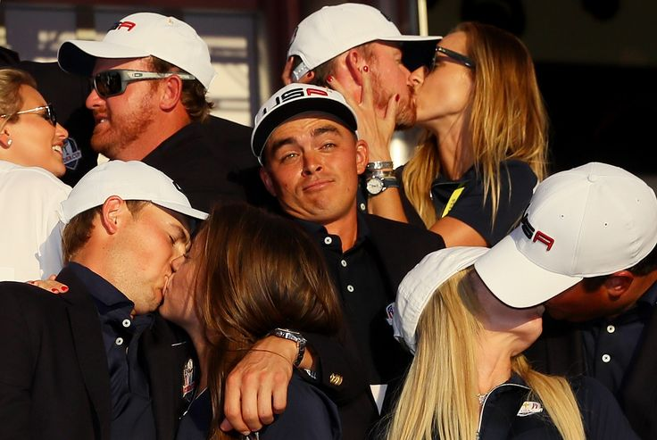 Best of 2016 - Rickie Fowler of the United States looks on as J.B. Holmes, Erica Holmes, Jimmy Walker, Erin Walker, Jordan Spieth, Annie Verret, Justine Reed and Patrick Reed celebrate during singles matches of the 2016 Ryder Cup at Hazeltine National Golf Club on October 2, 2016 in Chaska, Minnesota #FYS #Golf #RyderCup