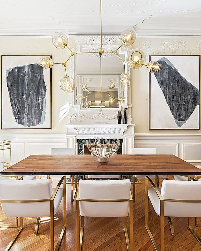 Poll: What's the best part of this dining space? Cast your vote in the comments below.  a. The glam white barstools  b. The chandelier (duh) c. Nothing beats that fireplace.  d. Wait, why would I choose one thing? | Photo: @EklundStockholmNewYork