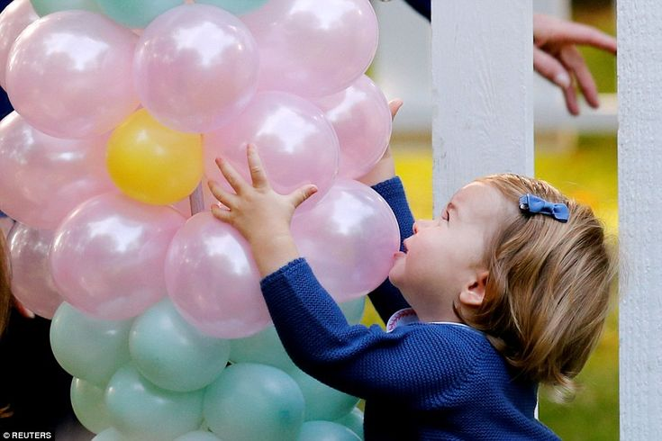 Princess Charlotte grabbed on to the balloon arch, saying 'pop' - the first word the littl...
