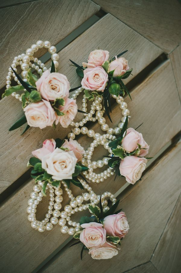 Pink rose and pearl corsages. Calie Rose Floral & Event Design.   photography by http://chantelmarie.com/