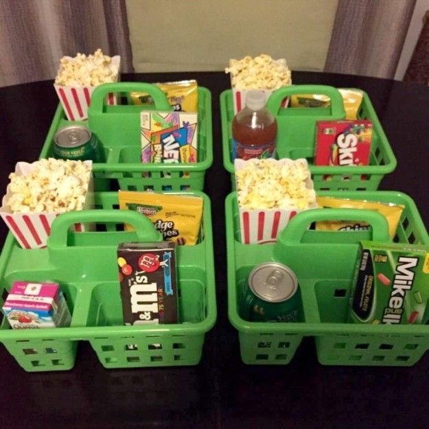 Host a movie night that (might) minimize squabbles over candy and popcorn — give everyone their own shower caddy full of treats.