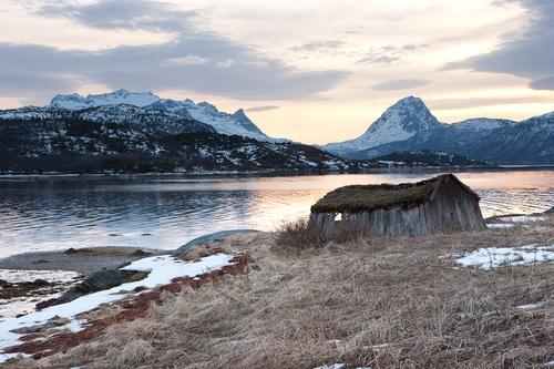 Old Boathouse in Sjøvegan in sunset