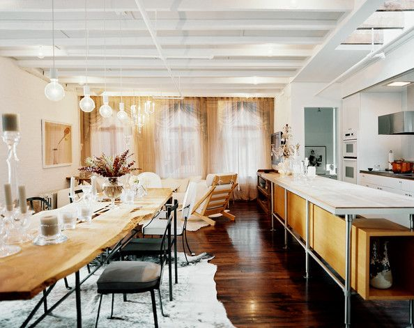 Dining Room Photo - A long live-edge dining table with mix-and-match chairs parallels a kitchen peninsula