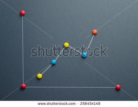 Growth graph concept made of colorful button shaped candies over dark blue background. This image is a photograph with a drawing over it.