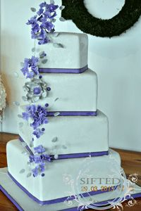 "Purple & Silver wedding cake - Purple & silver wedding cake, cake is dusted with disco dust (rainbow) gumpaste hydrangeas with silver centers and a silver ""fantasy flower with purple center) 12, 10, 8, 6"