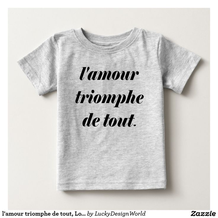 "l'amour triomphe de tout, Love conquers all Baby T-Shirt:This design features a French inspirational quote ""l'amour triomphe de tout"" with a little heart as well. The essential meaning of the words is ""love conquers all"". Love prevails and every heart is uniquely loving.    The design would make a great gift for a shower, birthday, for a festive occasion or for someone who likes all things French.  #typography #betype #lettering #love #motivation #lifestyle #LAmourTriompheDeTout"