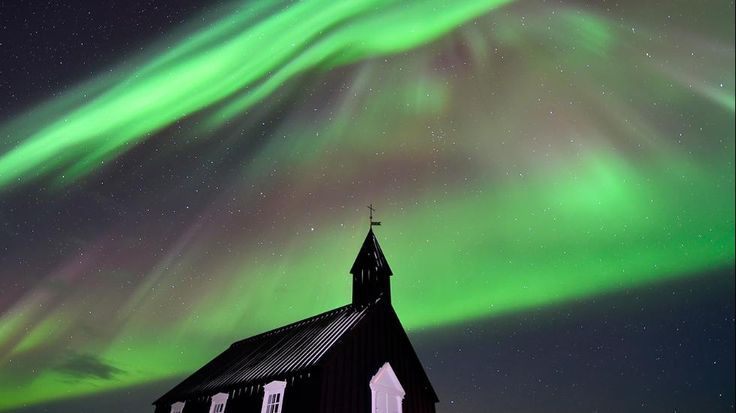 The Northern Lights over Black church at Budir on the Snæfellsnes peninsula, Iceland, in February 2015.