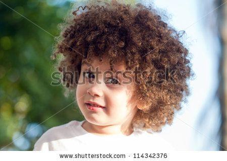 Cute, curly hair boy closeup by Wilson Araujo, via ShutterStock