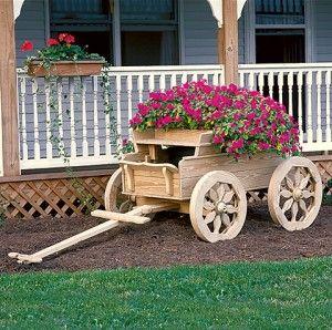 decorative wooden wheelbarrow planter | Wheelbarrow Planter – Outdoor Container Planting Tips | Patio ...