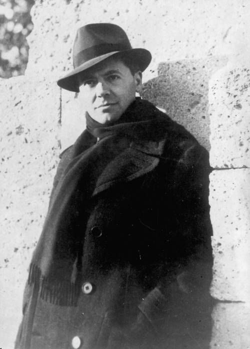 Jean Moulin, a fighter in the French Resistance. He wears a scarf here to hide a scar he inflicted on himself in a suicide attempt after being arrested by the Germans.