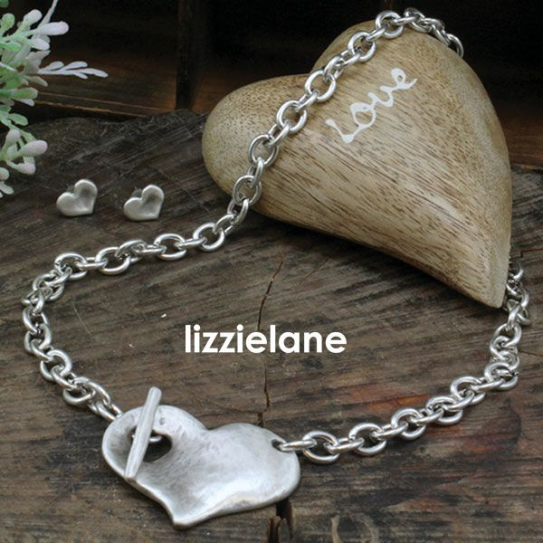 The Dramatic Danon Chunky Silver Necklace With Chunky Heart Pendant from the celebrated designer brand is an instant hit here at Lizzielane.  Featuring a striking concave medium size antique hammered silver heart design on a chunky silver link chain.