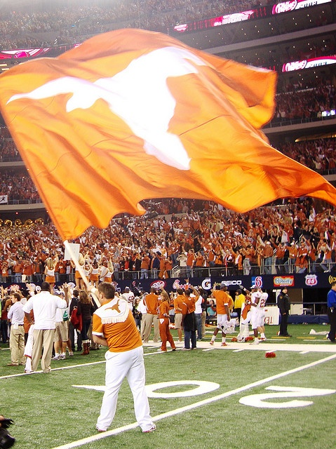 Waving Texas Longhorns flag after UT game