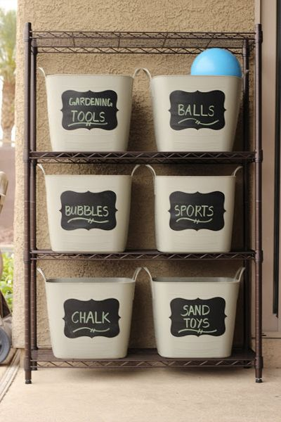 Get your backyard organized with labelled tubs for the outdoor equipment so that everything is easy to find and put away, and can be easily kept organised!