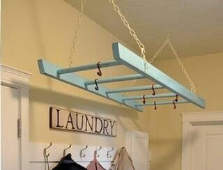 I want this ladder hanger for the CDs! #laundry #organization