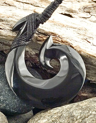 Black Onyx Maori Style Fish Hook hei matau Pendant.....these are made in new zealand. This symbol means good luck and safe passage over water.
