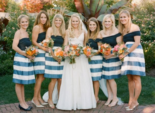 striped bridesmaids dresses | Stacey Hedman Photography/Anne M Cramer via Style Me Pretty