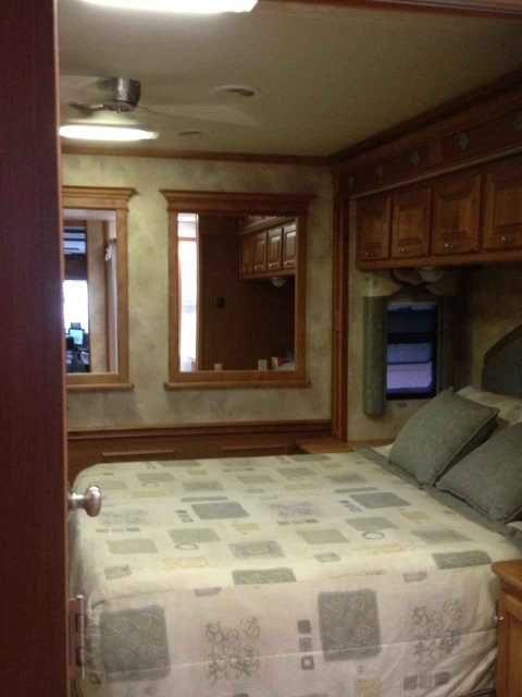 """2009 Used Tiffin Motorhomes Allegro Bay Class A in Florida FL.Recreational Vehicle, rv, GREAT PRICE!! Now $74,900 for our 2009 Tiffin Motorhome Allegro Bay , LOCATED IN VENICE, FLORIDA; SELLING DUE TO BUYING HOME IN FL. EXCELLENT CONDITION: ONE OWNER, NO PETS, NO SMOKERS. 3 slides--opposing slides in main cabin & 1 in bedroom; 26"""" outside TV; full body paint; dual pane windows, 2 roof A/C with heat pumps; driver door; slide-out covers; 7 KW Onan generator; Heated wet (water) bay; heated…"""