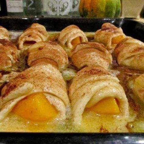 Peach Dumplings made with Mt. Dew (and crescent rolls) [if peaches aren't in season use 2 cans of sliced peaches in JUICE]or use apple pie filling with7-up..
