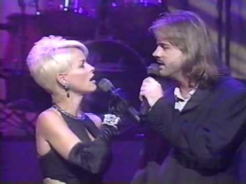 "Lorrie Morgan and Jon Randall - ""By My Side.""  One of the most beautifully written country love songs you will ever hear."