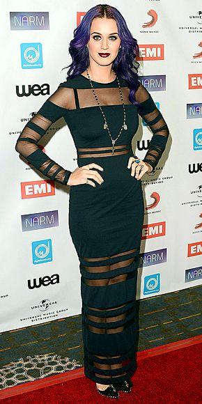 KATY PERRY  Embracing her dark side with a new purple do, the singer shows sections of skin in a sheer-striped black maxi, black bow pumps and on-trend dark lips for the NARM Music Awards in Century City, Calif.