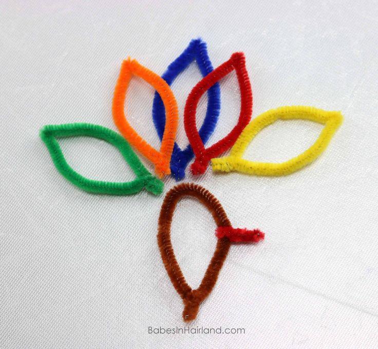 Feathers for Turkey Bun for Thanksgiving from BabesInHairland.com #thanksgiving #bun #turkeybun #hair #hairstyle