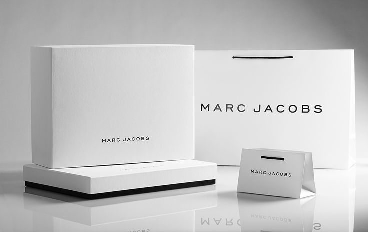 March Jacobs luxury retail packaging in both white and black retail boxes and retail shopping bags.