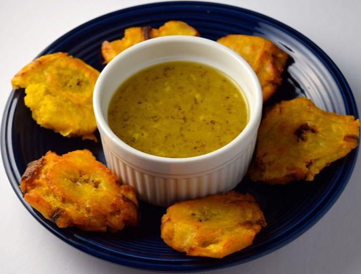 Tostones (Fried Plantains) with Mojo (Garlic Sauce) :http://www.cheftimestwo.com/tostones-fried-plantains-with-mojo-garlic-sauce/