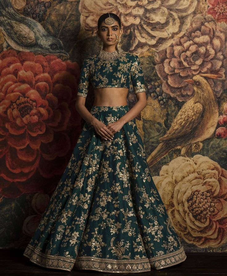Forest green lehenga embroidered with gold floral motifs and elbow length sleeves on blouse - Sabyasachi 2016