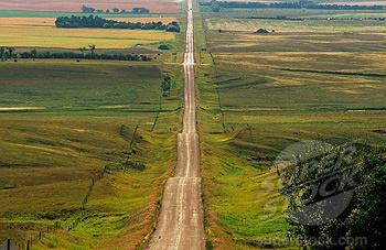 Long Saskatchewan gravel roads. Reminds me of trips to camp.