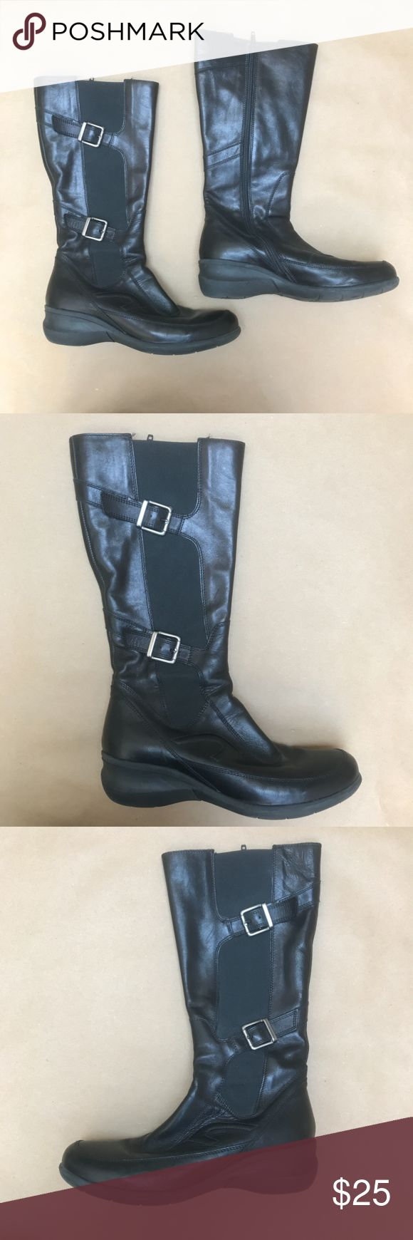 """Italian Black Leather Moto Boots Ciao! Bought new while traveling through Italy. Although not frequently worn, these show normal wear (e.g. creases). These are black leather tall boots made in Italy by Frau. Zipper. Silver buckles. 14"""" tall (from heel to top of boot). Top of boot measures 7"""" wide and narrows down to 5"""". Very comfortable. Please examine photos closely and reach out with questions before committing to purchase. Thx! Frau Shoes Combat & Moto Boots"""