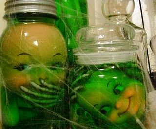 freaky jars with doll parts and green food colored water