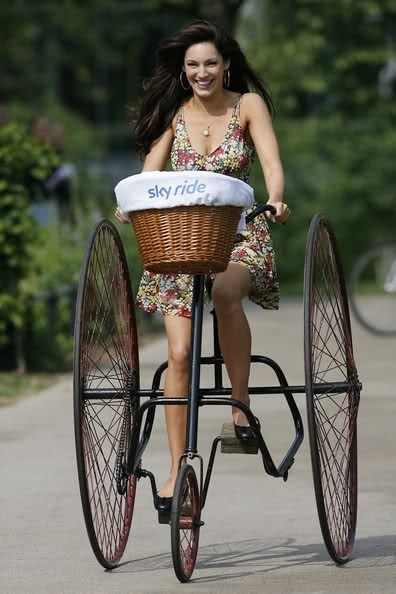 Kelly Brook on a Victorian Tricycle