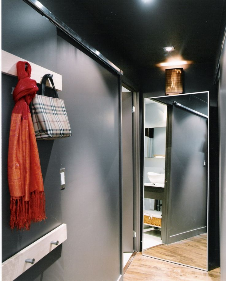 Studio Loft on King St. Custom sliding panel with coat hooks, custom light fixture. #interiors #interiordesign #Toronto #designinspiration #customclosets #design