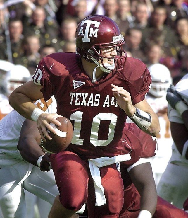 Texas A&M quarterback Mark Farris rolls out for a pass against Texas in the 2001 match-up.