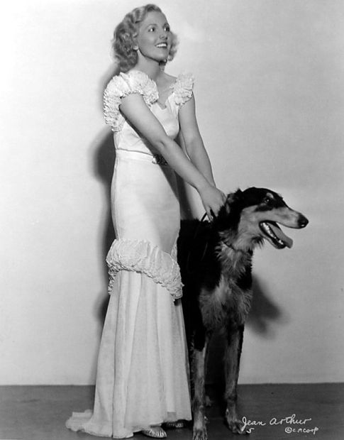 Jean Arthur with her dog.It's interesting to see what breed of dog a certain actor chooses. Arthur with a sight hound, but I'm not an an expert at identifying all dog breeds.