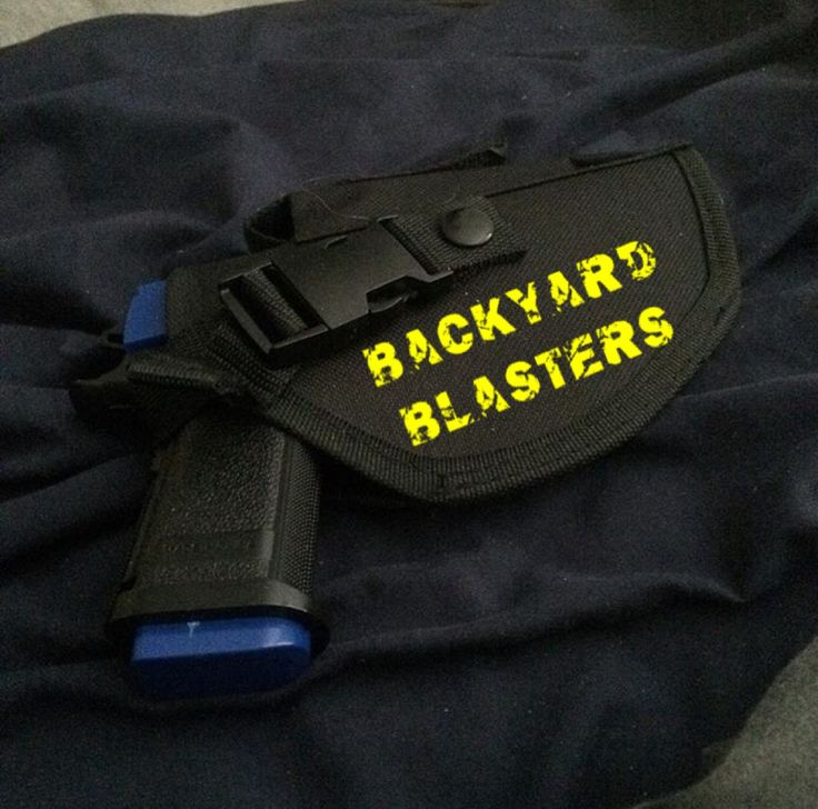 Our M1911 Foam Dart Gun sleeping snugly inside the tactical waist holster.  #1911 #toygun #nerf #blaster #nerfhandgun #nerfpistol #holster #dartblaster #sleeping #bed #backyardblasters
