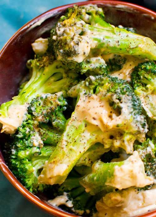 Recipe for Creamy Garlic Broccoli - Creamy garlic coats steamed, roasted garlic  an accent of black pepper over top. Find out what my secret one-step ingredient is to make this healthy-delicious side dish!