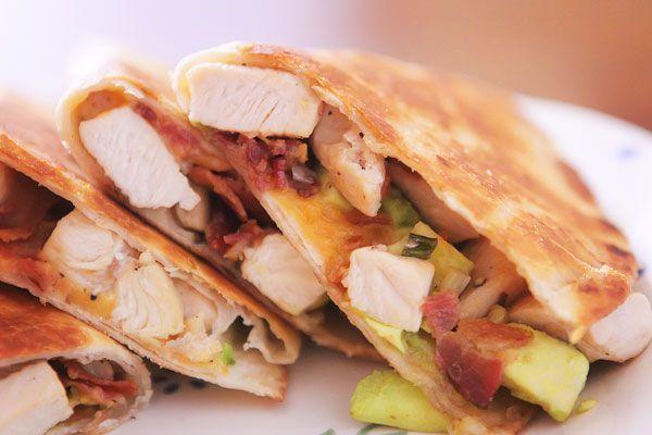 Cheesy chicken, bacon and avocado quesadillas.